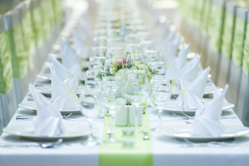 Event table linens in white and pale green. Party rentals also available.