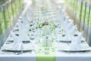 Event table linens in white and pale green.