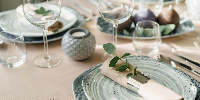 nj linen rentals - table setting with tan tablecloth and napkins